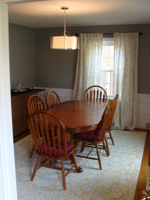 Dining room table seats six.