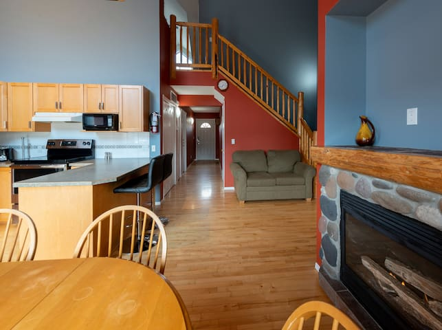 entrance hallway, kitchen, and staircase leading up to the loft living area