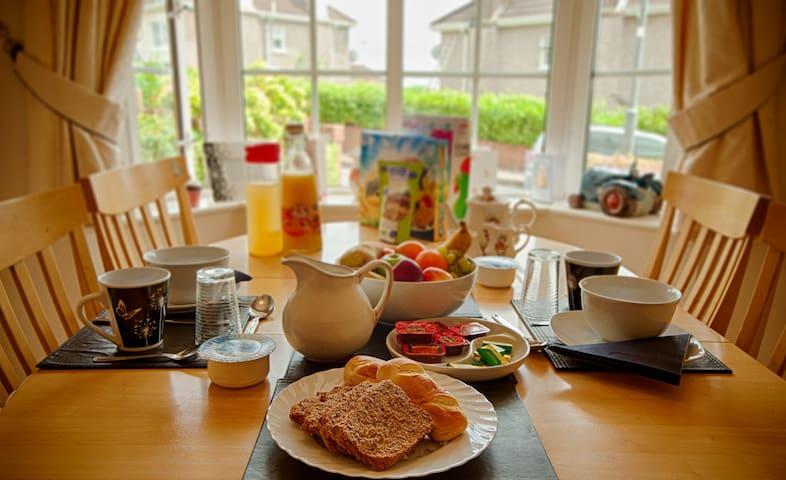 Varied breakfast-selection of fresh fruit,  3 to 4 cereals, Greek yogurt, home made brown bread, fresh baked rolls, Irish Cheddar cheese, jams/marmalade/honey, boiled eggs,apple/orange juice, coffee/tea/green teas.