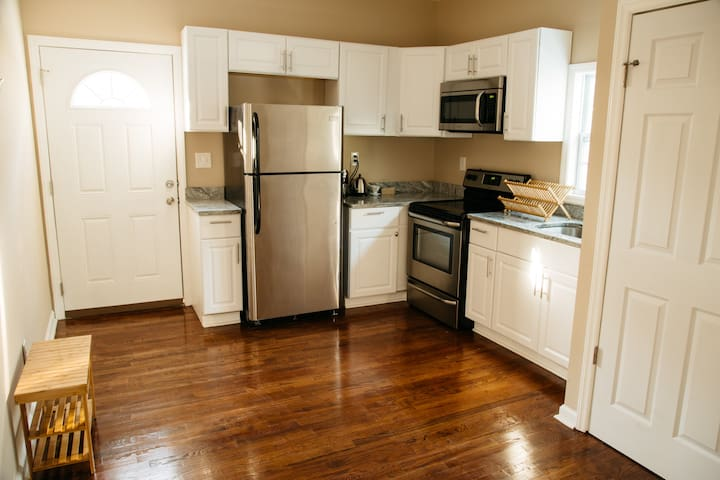 Lovely kitchen with new stainless steel appliances.