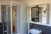 Shower in en suite bathroom with access from the hallway