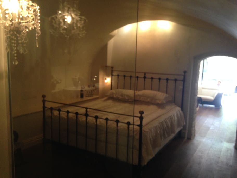 The romantic bedroom with lookthrough at the living room and the canal