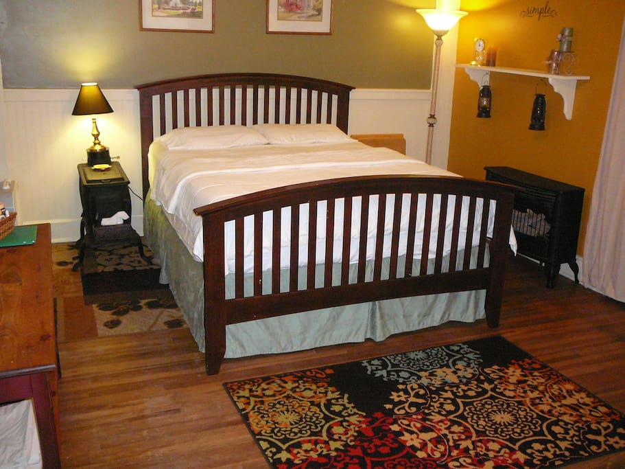 Queen-size bed in a cozy guest room perfect for couples traveling together