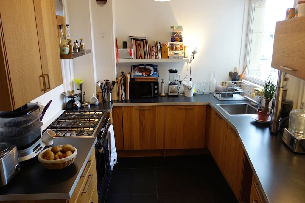 Our fully and more equipped kitchen with american fridge and large stove and oven
