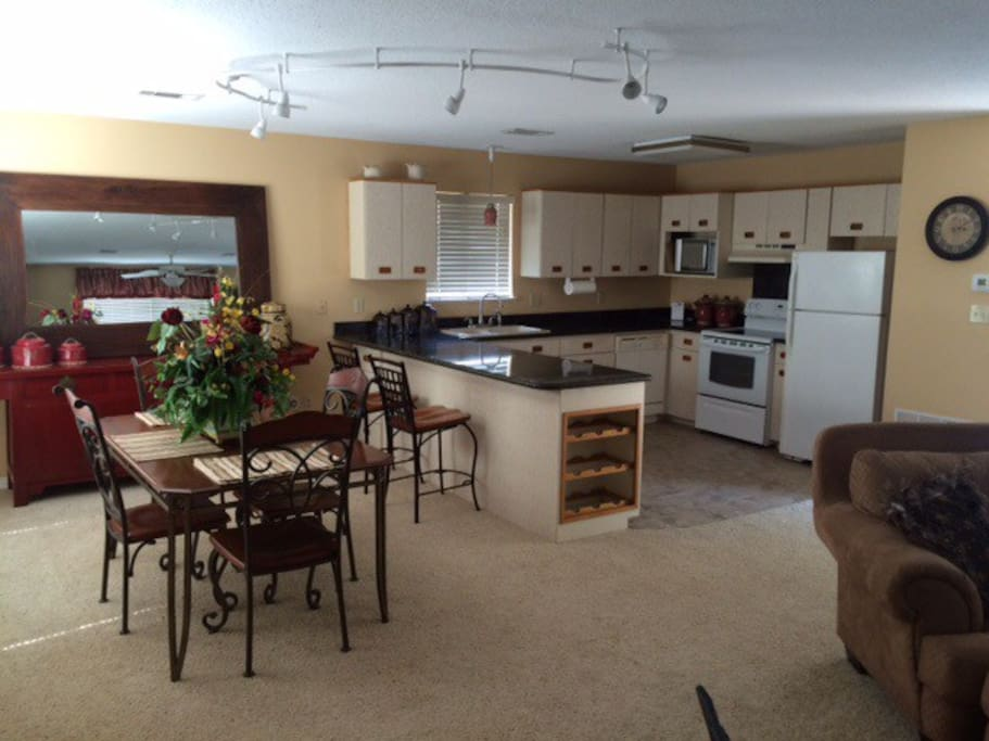 Full kitchen and dining area with washer and dryer.