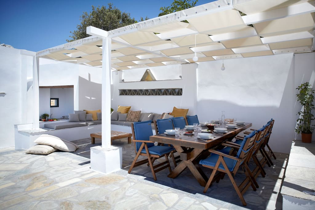 first floor terrace with dining table, lounge and outdoors kitchenette