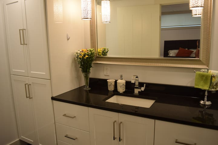 Bright bathroom with lots of cupboard space.  Full tub and shower.