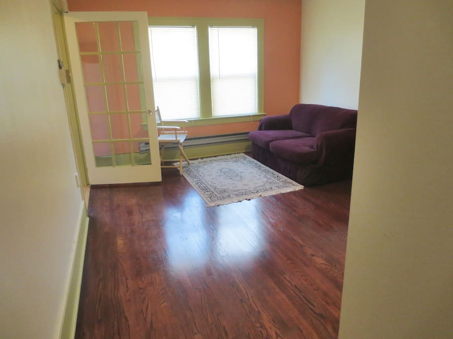 Beautifully refinished real hard wood floor in cherry wood color on the bright 2nd floor