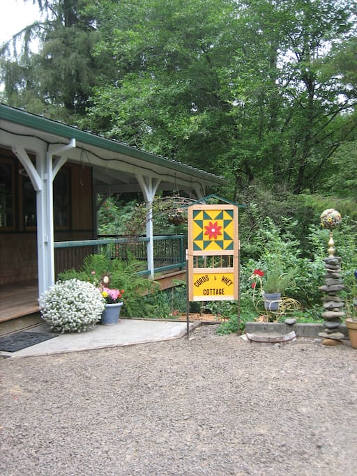 Entry to your cottage lodging space and parking area.