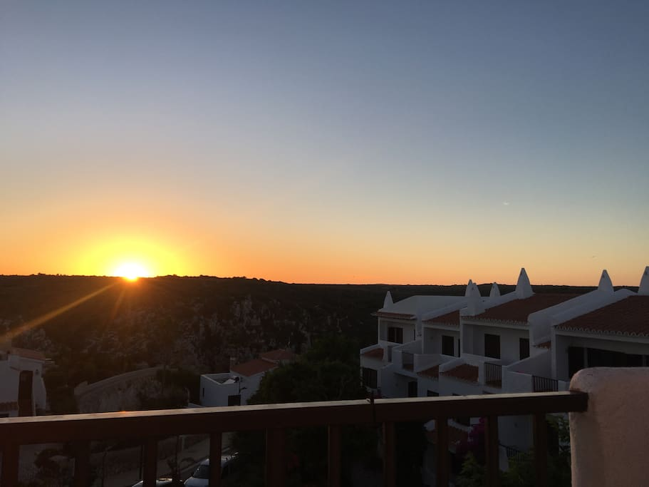Sunset over Cala Porter bay magnificent view from the terrace