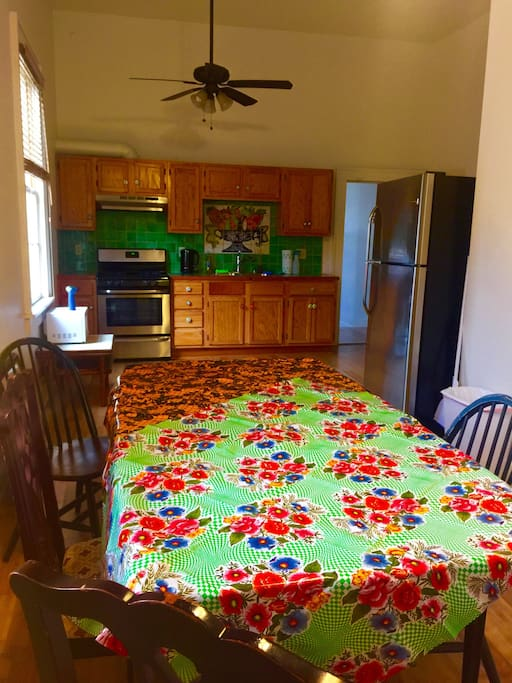 Large dining table connected to the kitchen for lots of group fun