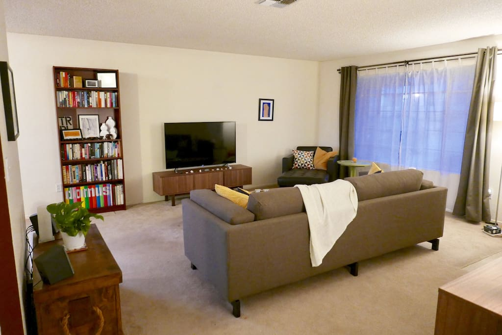 """The living room with a 55"""" roku TV. Netflix and Hulu available."""
