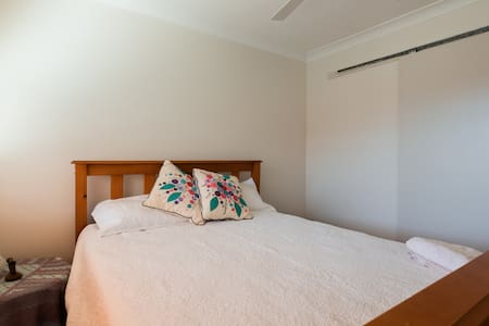 Comfortable queensize bed in home for females only