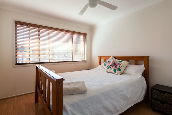 Comfortable queensize bed in Home.