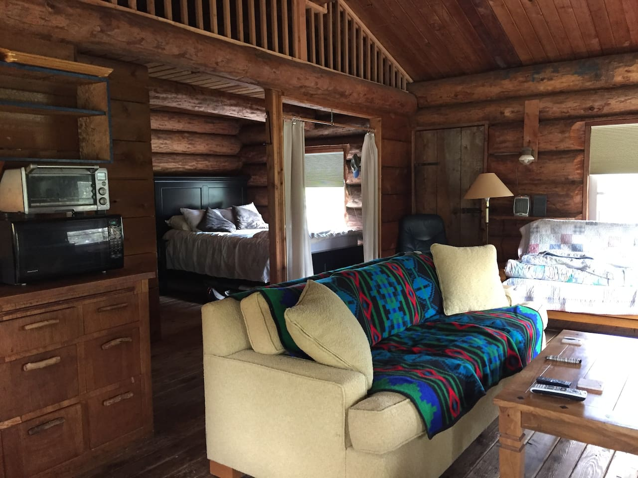 Stay in a real log cabin, 1 luxurious queen size bed plus 2 queen size sleeper sofas. Full kitchen and loft for the kids makes this the perfect family get away. Wifi and cell phone service included to stay connected while away.