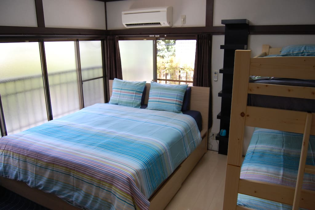 bedroom with queen bed and bunk bed.