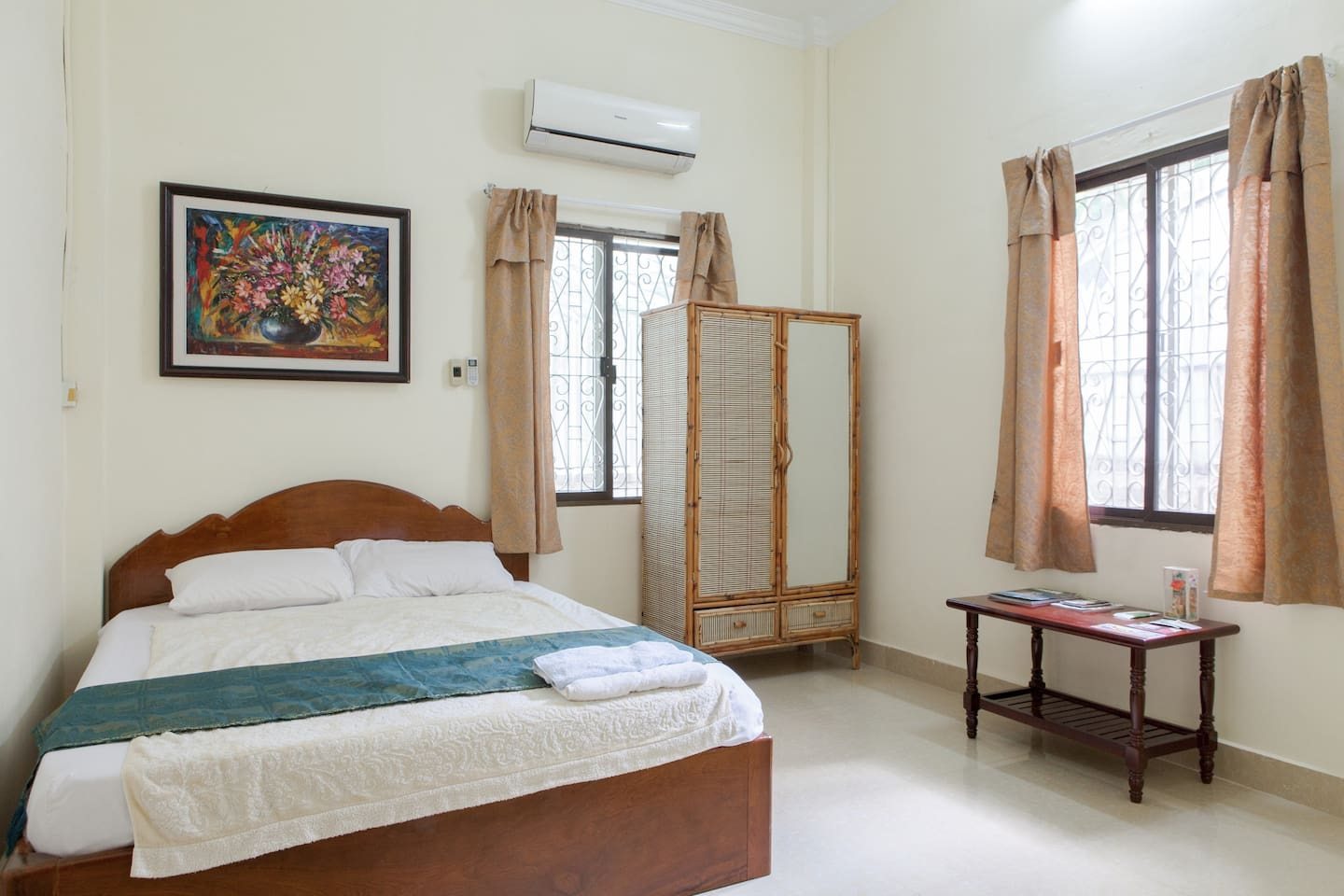 A simple a/c bedroom with attached bathroom in a 4 bedroom villa awaits you!