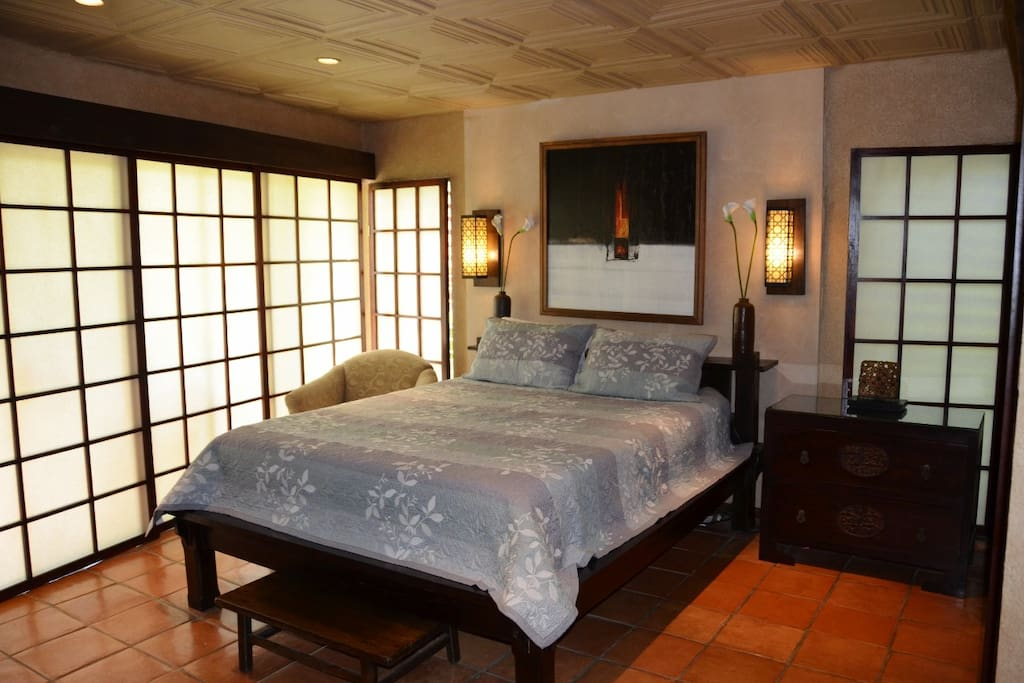 Master bedroom suite with Shoji privacy screens, patio,TV/DVD armoire, full bath