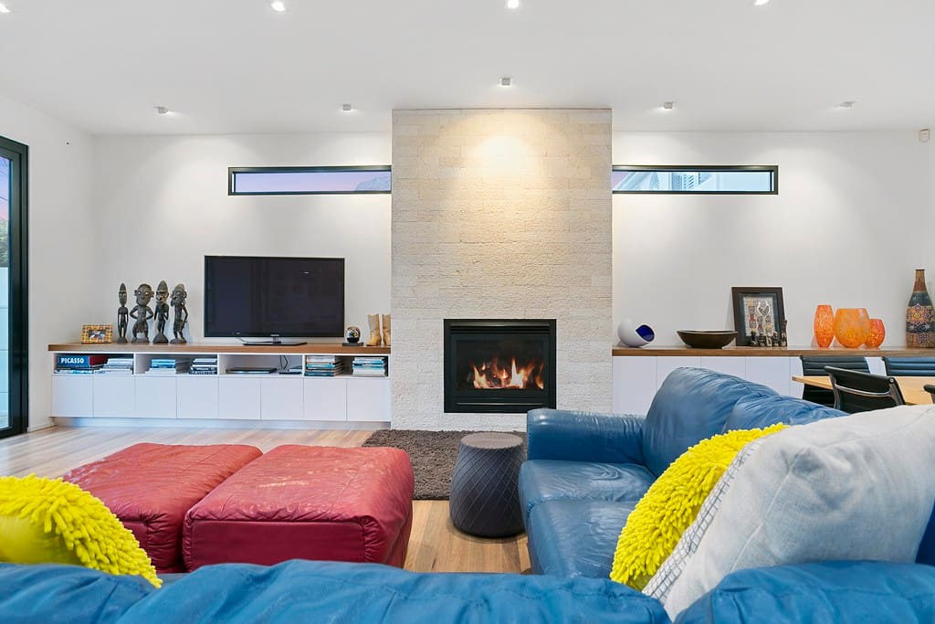 Lounge with sofa bed and gas fire place