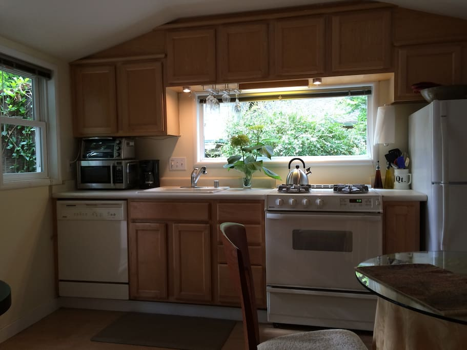 Full kitchen w/DW, stove, toaster oven, microwave, coffee maker...