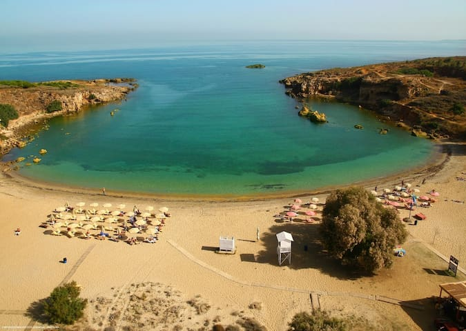 The beach of Agii Apostoli, 1.4km from the villa