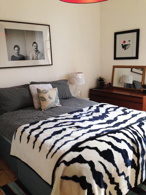 Comfy king-sized bed, side tables, lamps and dresser