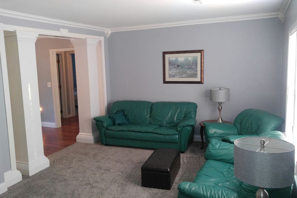 Front Room With leather Couch, love seat & oversized Chair