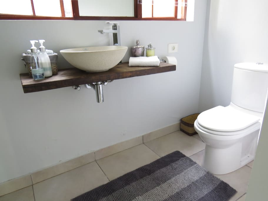 Bathroom includes basin, toilet and shower