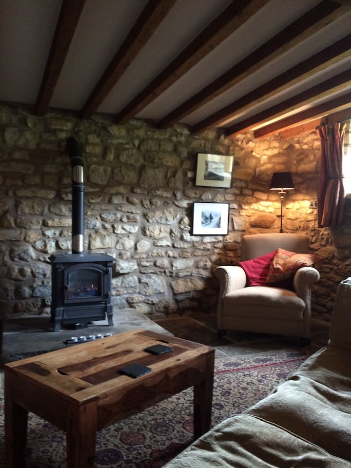 Cosy, comfortable sitting room with plenty of light beamed ceiling and log effect fire .