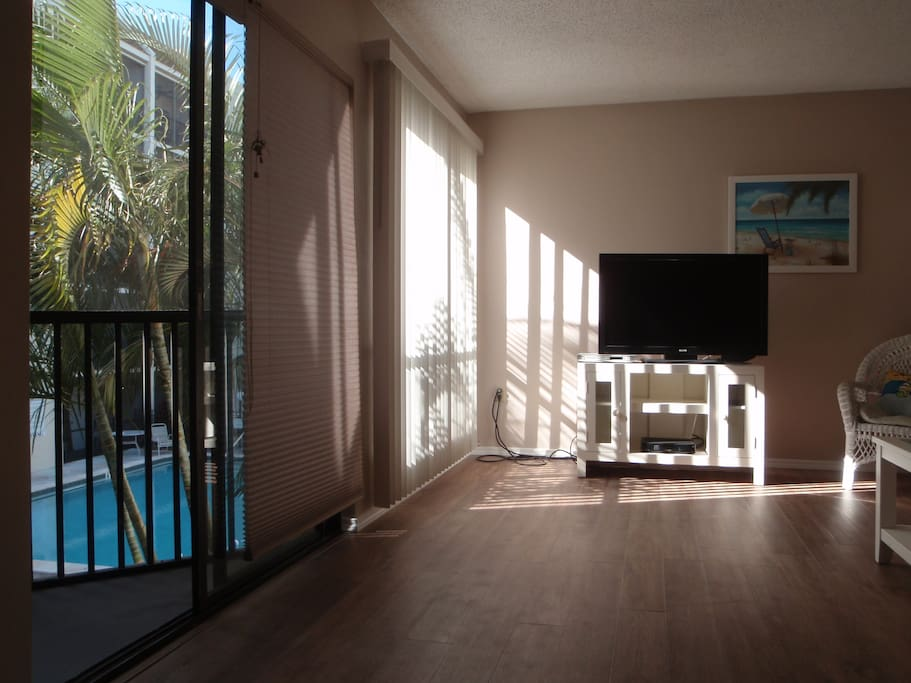 Living Room with pool view balcony