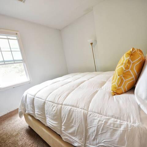 Bedroom 1- Upholstered Queen Bed with pillow top super comfortable mattress