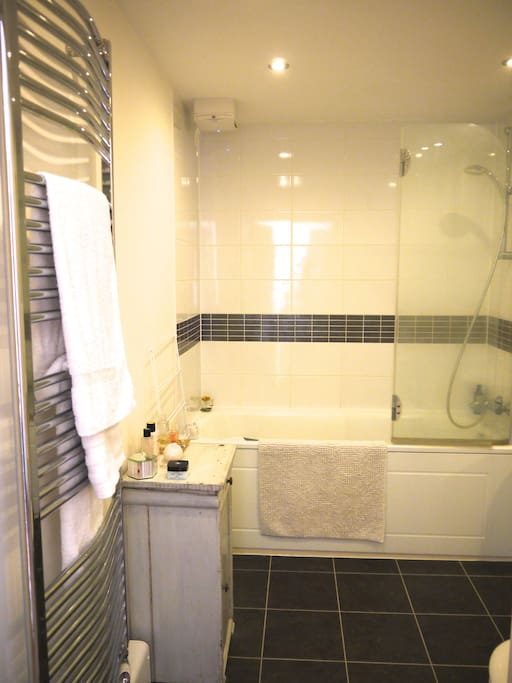 Spacious Bathroom with bath and shower