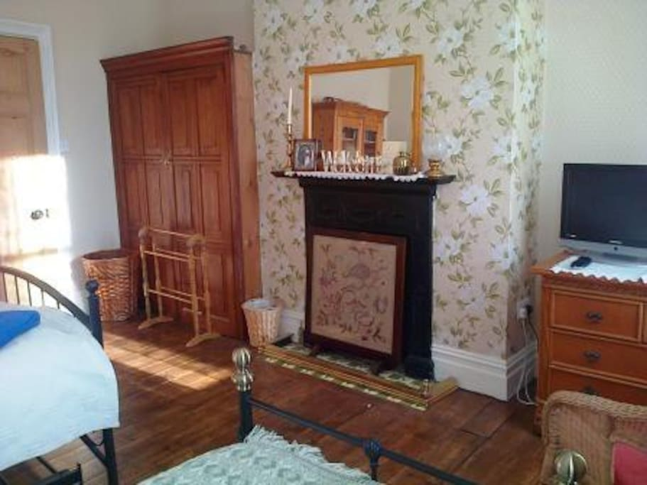 Large victorian room with high ceiling, coving,sash windows and working fireplace.