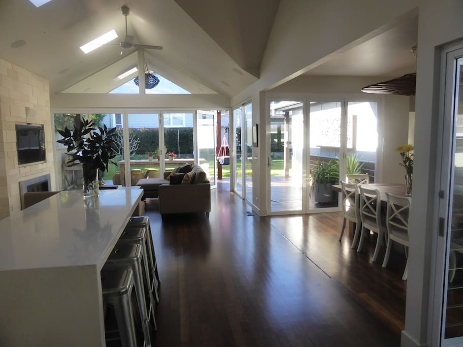 Large airy and light filled living area with bifold doors that open the space to the outside.
