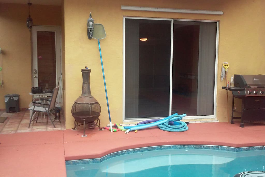 Your room has a sliding glass door out to the pool area. You can use our grill to cook outside.