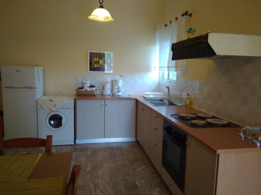 Kitchen with big fridge and washing mashine