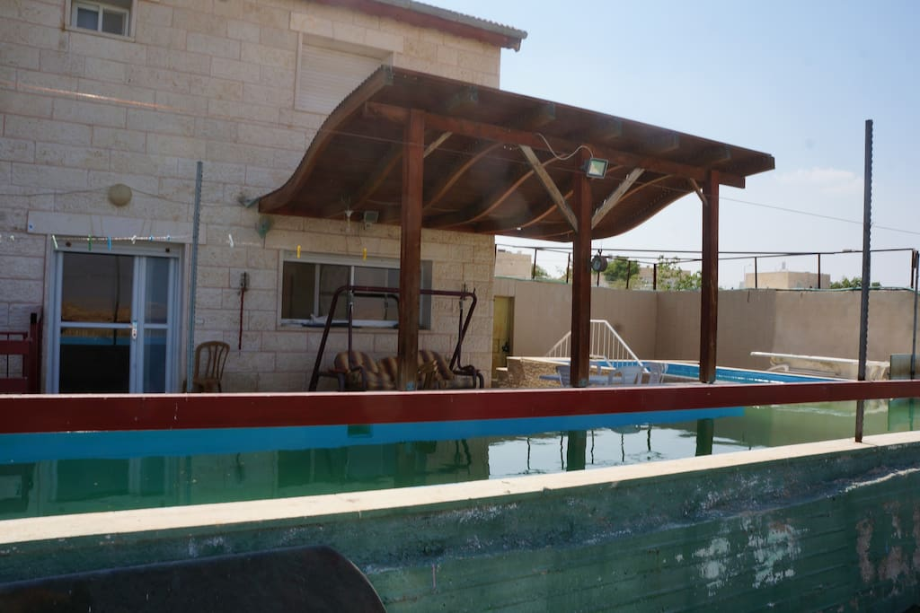 Apartment pool entrance and pergola/Succah
