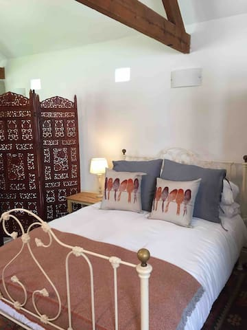 Double bed in living area