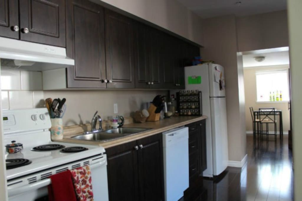 Full kitchen with pantry room, grocery store is a block away
