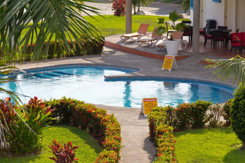 Relax by the Swiming pool - BBQ pit is available in the club house
