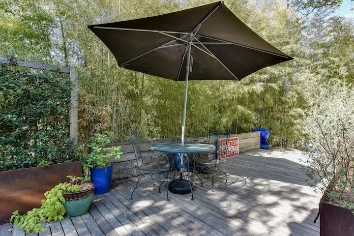 Enjoy a private patio deck with umbrella and natural privacy..