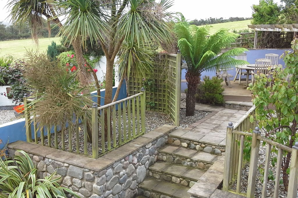 Lovely sheltered back garden with sea views and plenty of sun traps