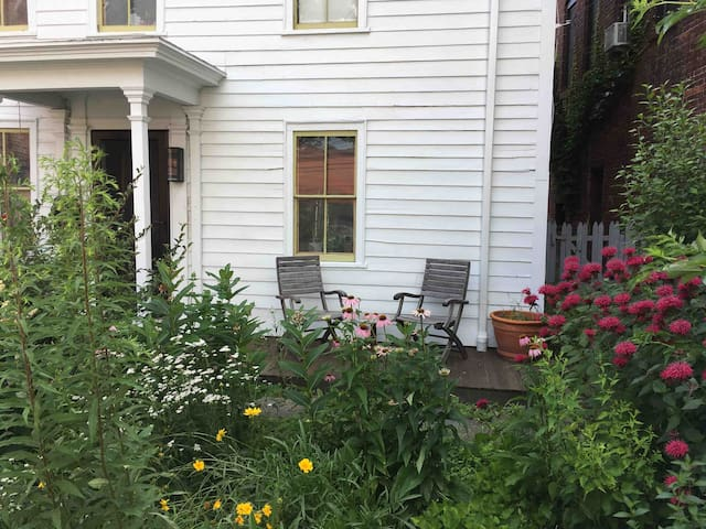Front deck for guest use.  If you visit in the spring or summer you can enjoy the bountiful gardens.