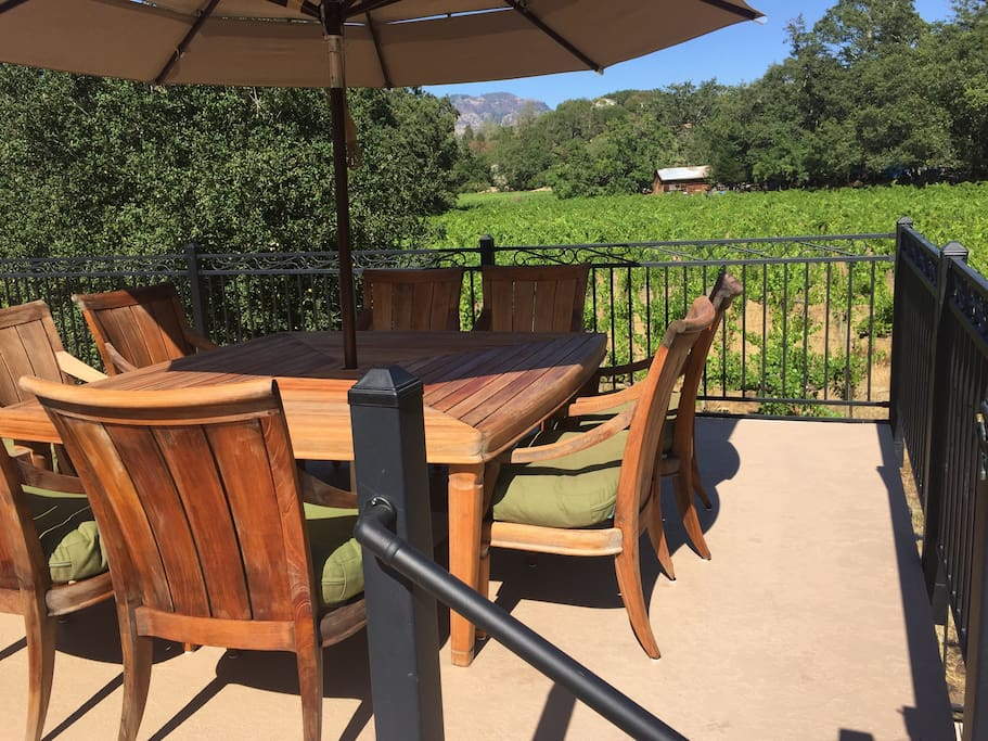 Upper deck dining area enjoys a birds eye view of the Palisades cliffs and the adjacent organic vineyard.