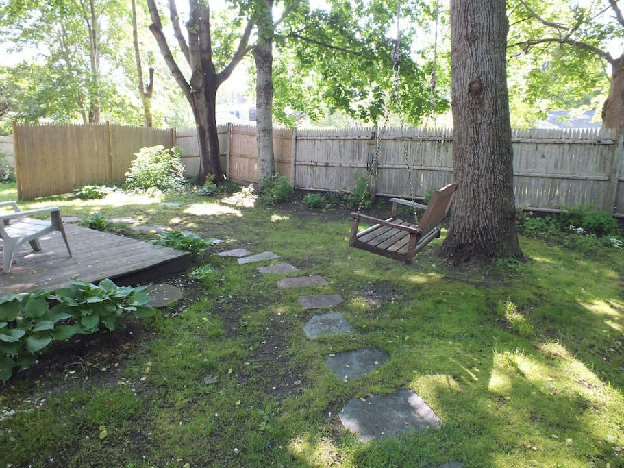 Private fenced in backyard (note, the swing is no longer there)