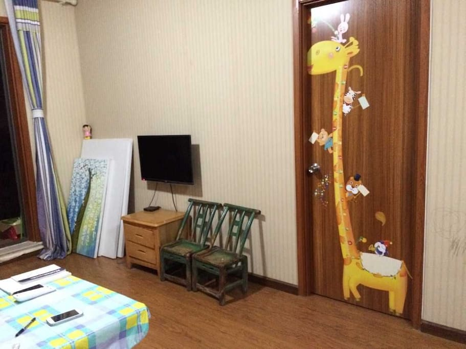 living room, with sofa/tv/refrigerator available, free WIFI, washing machine is on the balcony