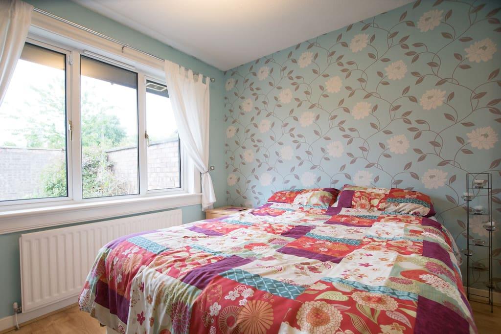 Light-filled bedroom with plenty of storage.