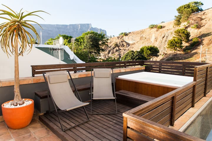 Enjoy the hot tub on the rooftop terrace with views of Cape Town's iconic Table Mountain and the Atlantic Ocean.