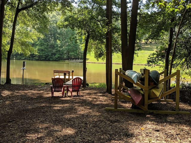 Our lake for sharing.  Sit and relax with a glass of wine or take the kayak out on the lake.  Guests have direct access from our dock.