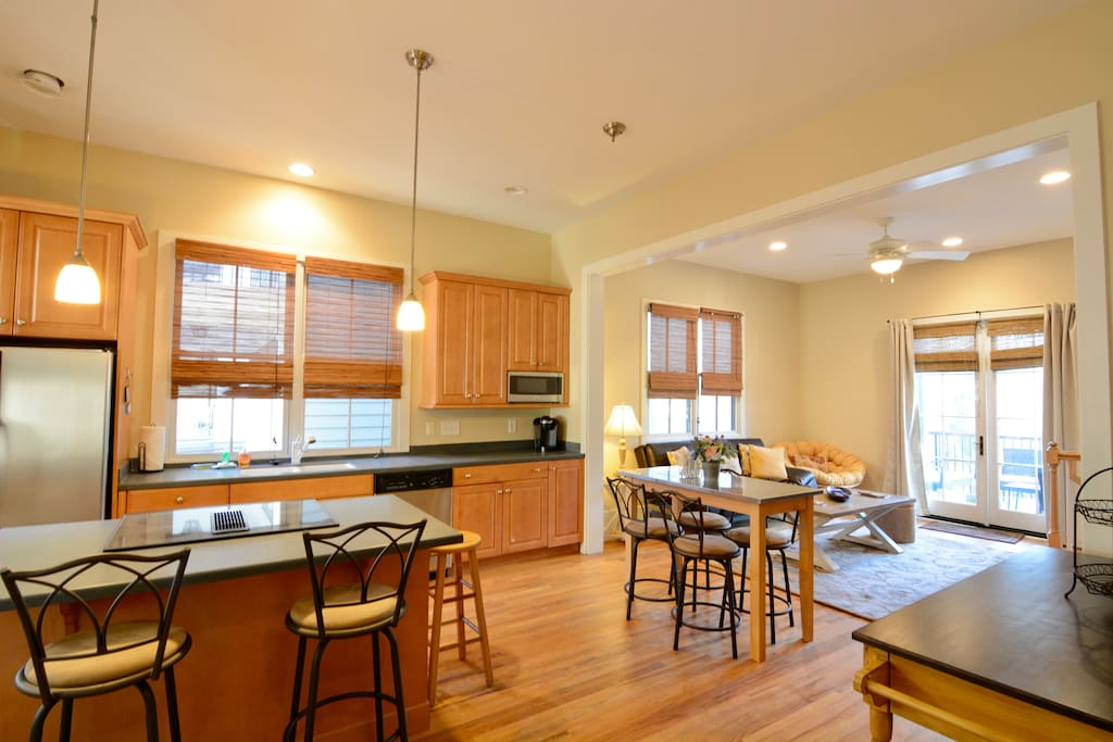 The open-plan kitchen, living and dining area is a great place to cook, dine and socialize with other guests
